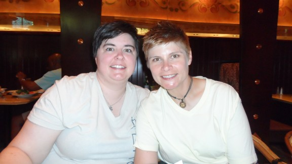 "Same-sex couples in the 37 states that do not allow gay marriage found themselves struggling with conflicting feelings after two key Supreme Court decisions. ""This ruling changes nothing on a personal level,"" said Brandi Ansley, right, who lives with her partner in Georgia, which does not allow same-sex marriage. Still, ""it"