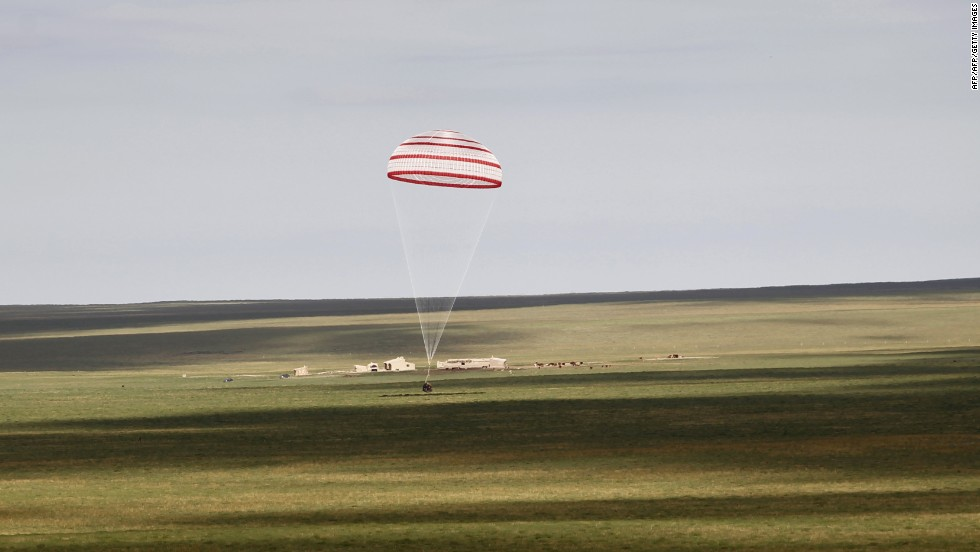 The return capsule of the Shenzhou 10 spacecraft lands in the grasslands of Inner Mongolia in northern China on June 26.