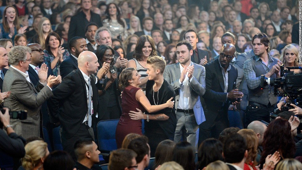 "Singer Justin Bieber and his mother, Pattie Mallette, share a hug at the American Music Awards. Mallette released a book in 2012 titled ""Nowhere but Up: The Story of Justin Bieber's Mom"" that chronicled her rise from being a teen mom with drug and alcohol addiction."