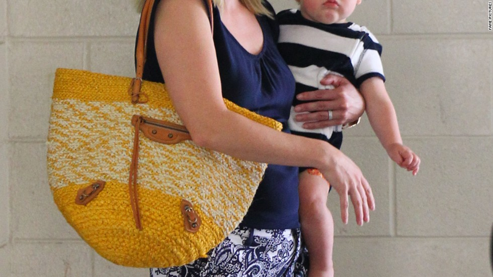Reese Witherspoon carries her son Tennessee while out in Los Angeles on June 26.
