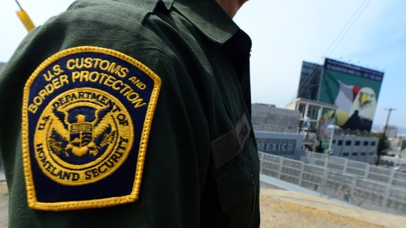 A U.S. Border Patrol agent stands near a crossing into Mexico at the San Ysidro port of entry in San Diego, California.