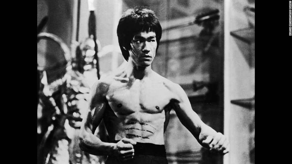 Hong Kong-American actor and martial artist, Bruce Lee poses in a fighting stance in a still from the film 'Enter The Dragon'.
