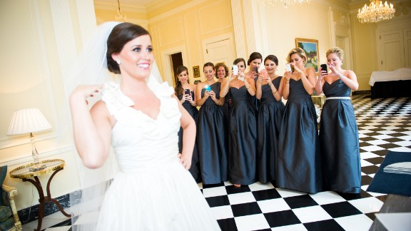 """""""I try to have fun with the camera phones everywhere,"""" wedding photographer Angela Garbot said."""
