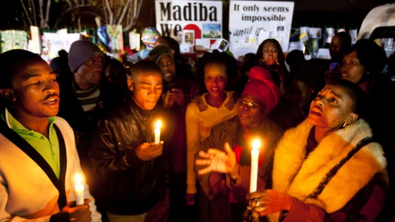 Well-wishers sing songs by candlelight outside the hospital on June 27.