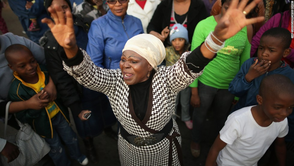 Florence Nyadzani leads those gathered in songs and cheers of support outside the hospital on June 25.