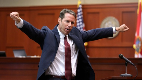 "Prosecutor John Guy gestures during his opening arguments on June 24. His first words to the six-woman jury may have raised a few eyebrows. ""Good morning. 'F*****g punks, these a******s all get away,'"" Guy quoted Zimmerman. ""These were the words in this grown man's mouth as he followed this boy that he didn't know. Those were his words, not mine."""