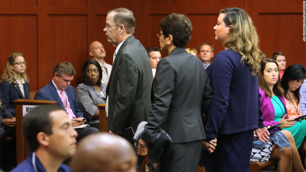 From left, Zimmerman's father, Robert Zimmerman Sr.; his mother, Gladys; and his wife, Shellie, are escorted from the courtroom on June 24. Since they are all on the witness list, the judge ruled they cannot be present in the courtroom until after they testify.