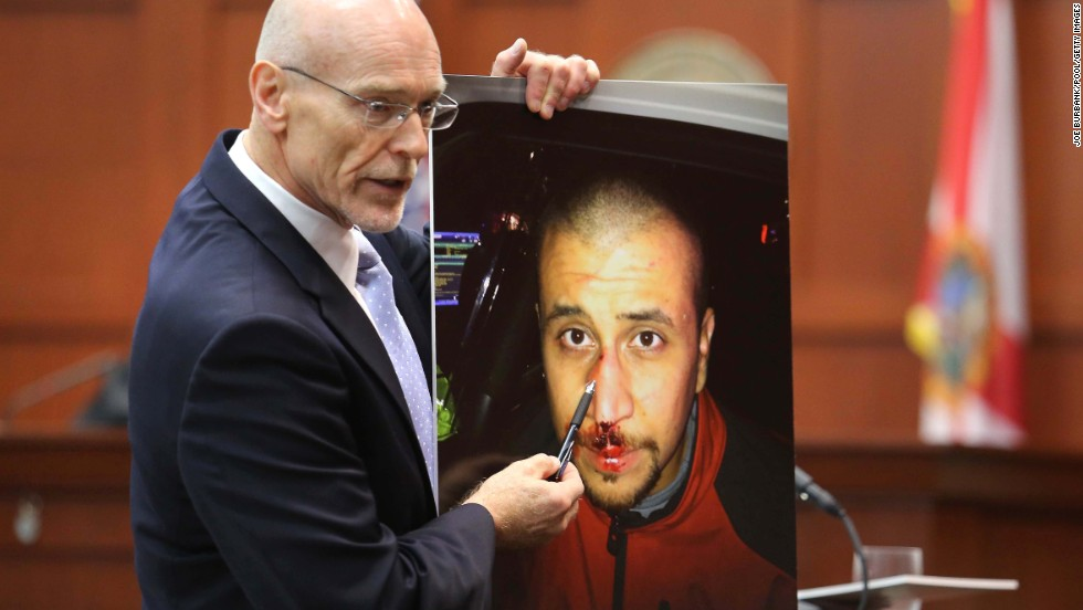 "Defense attorney Don West displays a photo of Zimmerman from the night of the shooting during his opening arguments on June 24. He opened his statements with a knock-knock joke but failed to win a laugh. ""Knock knock. Who's there? George Zimmerman. George Zimmerman who? Good, you're on the jury,"" he said."