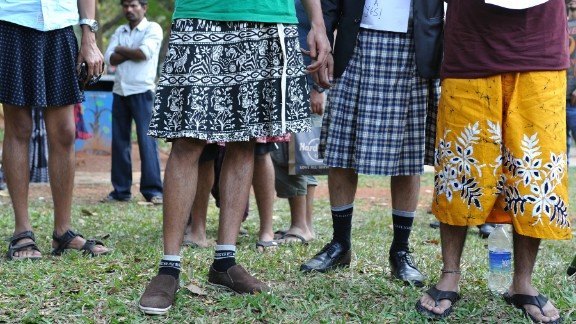 Men in Bangalore, India, wear skirts on January 12, 2013, during a demonstration against the rape and sexual abuse of women.