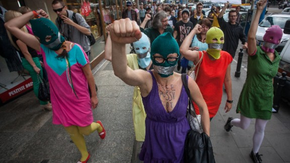 Supporters of the Russian punk band Pussy Riot wear masks and tape their mouths during a protest in front of the Russian embassy in Warsaw on August 17, 2012. The colorful ski masks were popularized by the feminist rockers.