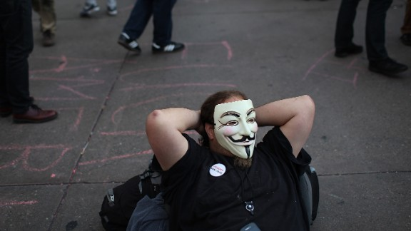 An Occupy protester wears a Guy Fawkes mask during a May Day demonstration on May 1, 2012, in Oakland, California. The mask has become a symbol of the Occupy movement.