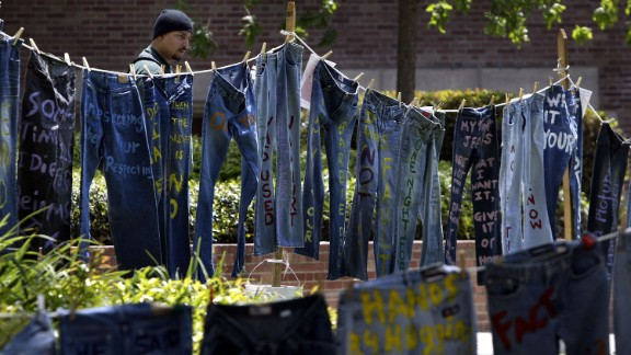 A man looks at blue jeans with messages challenging misconceptions about sexual violence at the University of California Los Angeles on April 21, 2004. Since 1999, wearing jeans on Denim Day became a symbol of protest in response to an Italian Supreme Court decision that overturned a rape conviction because, the justices reasoned, the victim wore tight jeans and must have helped her attacker remove her pants.