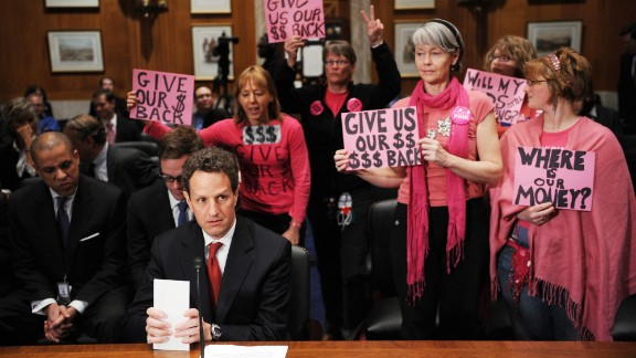 """Also claiming the color pink, members of<a href=""""http://www.cnn.com/2013/05/23/politics/gallery/medea-benjamin/index.html""""> Code Pink </a>often stand out in Washington. The group, a women-initiated peace activism organization, is seen here as Treasury Secretary Timothy Geithner prepares to testify at a congressional hearing on April 21, 2009."""