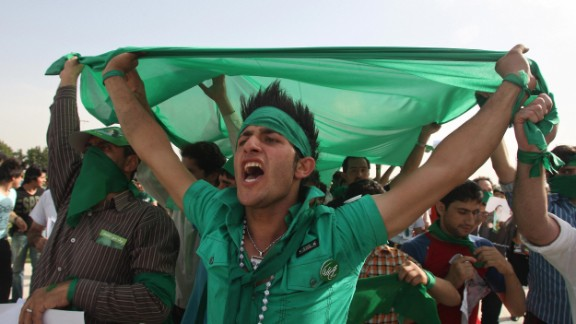 Supporters of Iranian presidential candidate Mir Hossein Mousavi shout slogans during a street campaign rally at Azadi Square in Tehran on June 10, 2009. The color green became a symbol of solidarity in the protests that followed the country