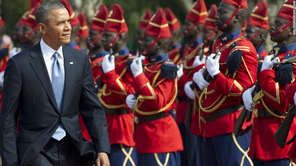 President Obama reviews an honor guard outside the presidential palace in Dakar on June 27.