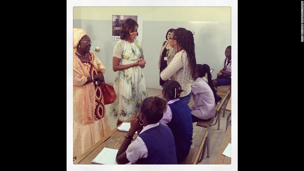 "Obama posted: ""'You all are role models for my daughters, which is why I brought them here today - so that they could be inspired by you just like I am.' -First Lady Michelle Obama at MLK Middle School in Dakar. #FLOTUSinAfrica"""