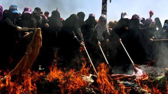 Yemeni women defiantly burn their traditional veils in Sanaa on October 26, 2011, in protest of President Ali Abdullah Saleh
