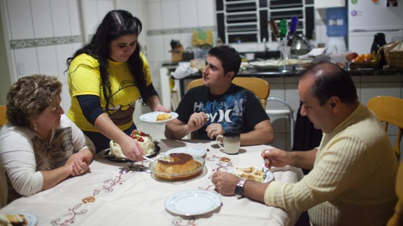The family of Renata Teodoro sits down for a meal without her. Her sister, Sabrina, brother, Rafael, mother, Gorete, and father, Joel, lived in Brockton, Massachusetts, for 15 years before being deported back to Brazil while Renata continues to live in Boston under the Dream Act.
