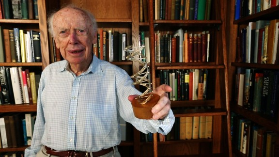 "James Watson, who won a Nobel Prize for co-discovering the structure of DNA, holds a model of the molecule. ""It hasn"