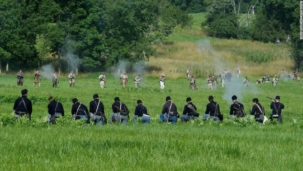 "Union soldiers are fired on by advancing Confederate troops. ""People are here to recognize and honor and commemorate what these people went through, the sacrifices of both soldiers and civilians,"" said an official with the Blue Gray Alliance, which put on the event."