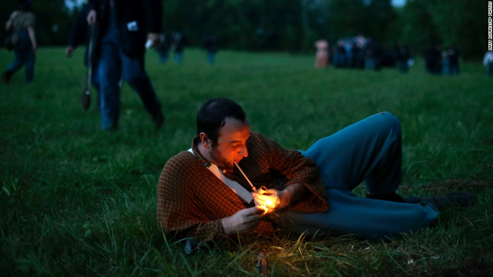 A Union soldier with Murray's Brigade lights his pipe at Bushey Farm in Gettysburg on Thursday, June 27.