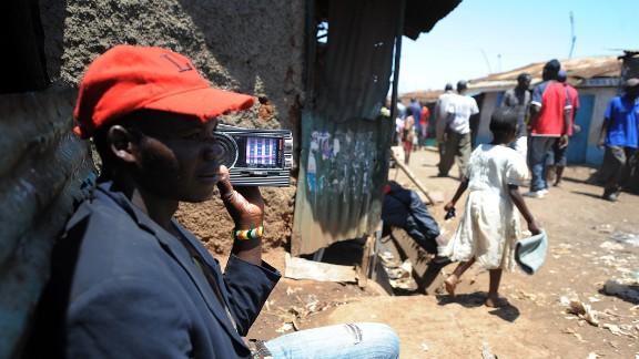 A man listens to a radio in the huge Kibera slum in Nairobi, Kenya, where Kennedy Obede grew up.