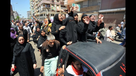 Mourners shout slogans during journalist Salah Hassan