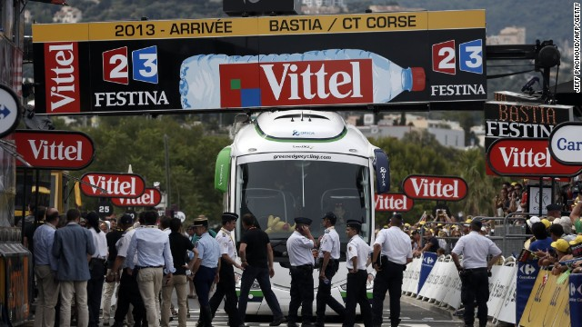 The Orica GreenEdge team bus is trapped under the finishing line of the first stage of the Tour de France
