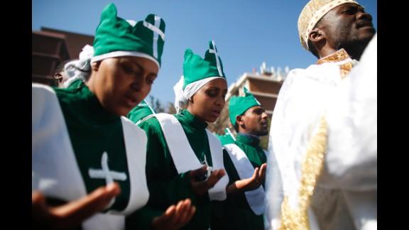 Members of the Ethiopian Church pray near the hospital on June 30.