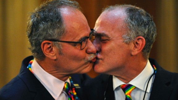 Jeff Foote, left, and Cosgrove Norstadt kiss during their wedding on San Francisco on June 28.