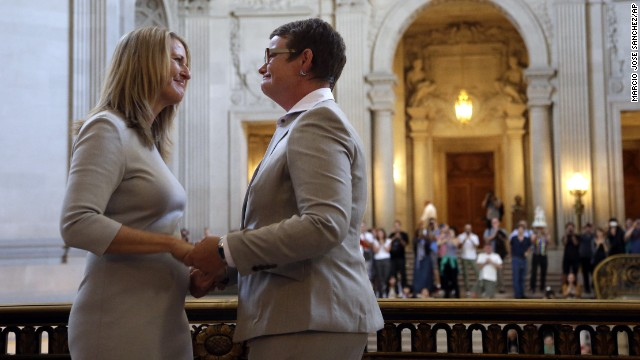 Sandy Stier, left, exchanges wedding vows with Kris Perry. Stier and Perry were the lead plaintiffs in the U.S. Supreme Court case that overturned California's same-sex marriage ban