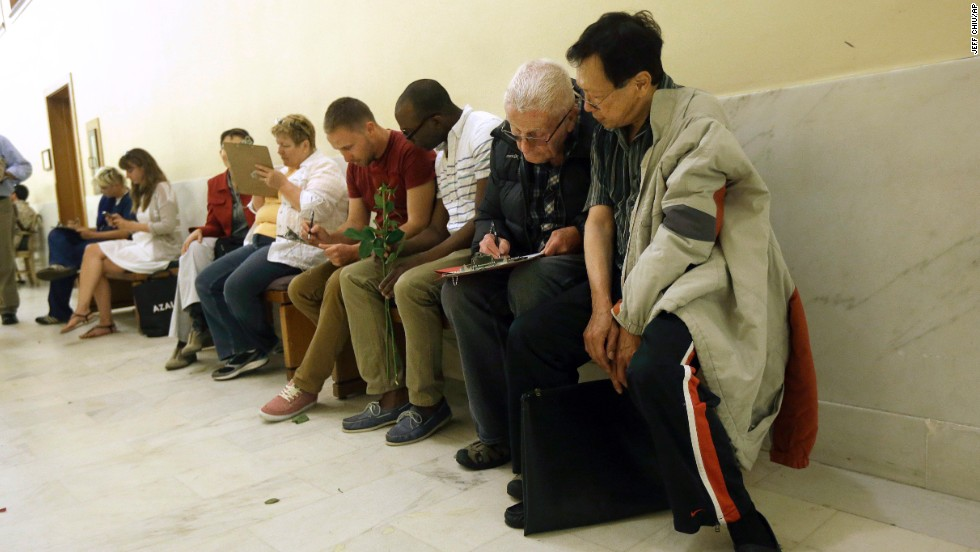 Couples fill out license applications as they wait in line at the San Francisco City Hall on June 28.