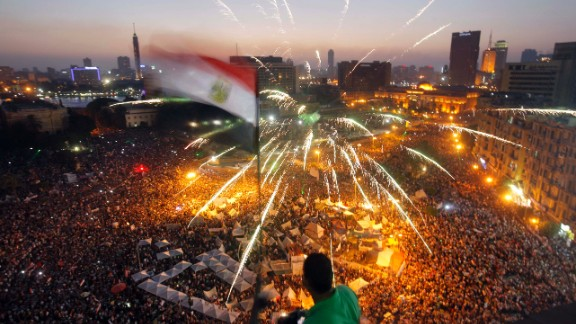 Morsy's opponents say his policies are to blame for a breakdown in law and order, for an economy that's gone south, and for a gas shortage that has Egyptians waiting at the pumps for hours. Here, protestors fill the streets of Cairo on June 30.