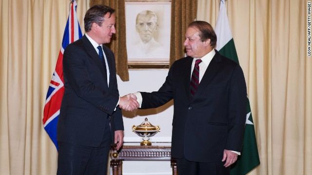 UK Prime Minister David Cameron (L) shakes hands with Pakistani Prime Minister Nawaz Sharif in Islamabad on Sunday.
