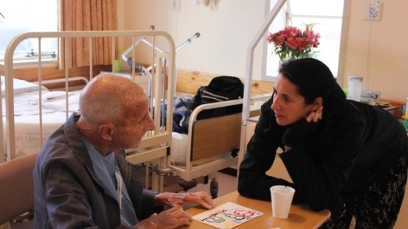 Patricia Repar, director of the University of New Mexico Hospital's Arts-in-Medicine program, works with a patient at a facility in South Africa. The UNM program collaborates internationally with the University of Cape Town's School of Medicine, according to its website.