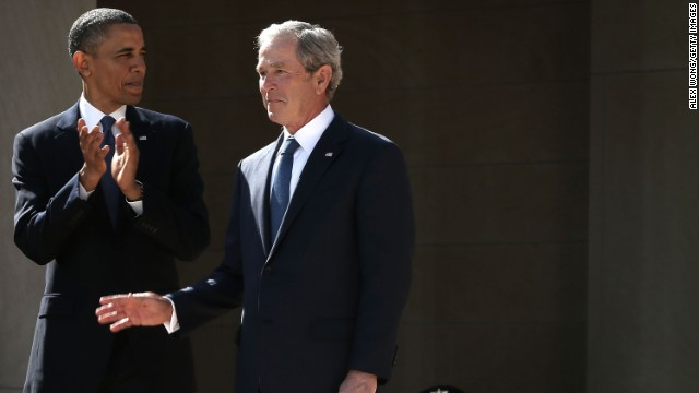 U.S. President Barack Obama (L) and former President George W. Bush (R) arrive at the opening ceremony of the George W. Bush Presidential Center April 25, 2013 in Dallas, Texas.
