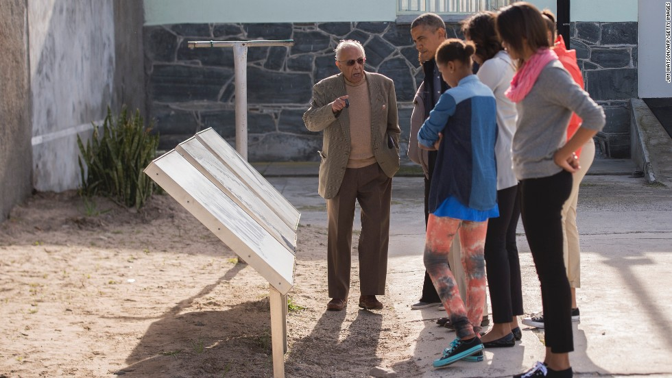 Ahmed Kathrada, a former fellow prisoner with Nelson Mandela, shows the Obama family around Robben Island  in Cape Town, South Africa, on Sunday, June 30. The island, where prisoners were banished and isolated during the apartheid era, is now a museum.