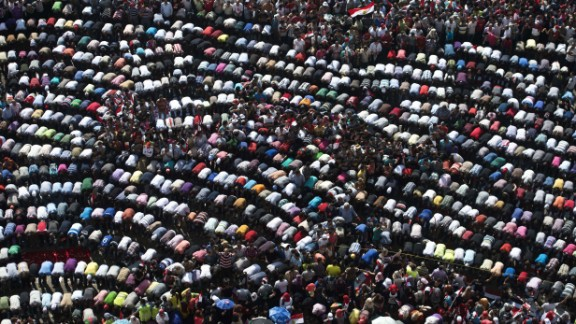 Thousands of opponents of Egyptian President Morsy pray during a protest calling for his ouster on Sunday, June 30. On the first anniversary of his inauguration, Morsy