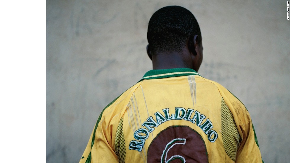 A player wears a hand-stitched Vento Inha FC shirt, in Pacasse, Mozambique, with the name of former Brazil international Ronaldinho emblazoned across the back.