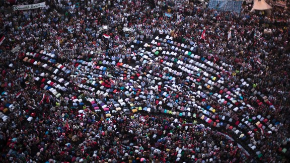 Protesters pray during a demonstration against Morsy in Cairo