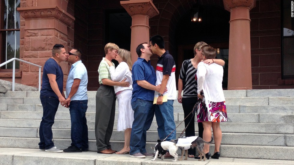 Same-sex couples kiss on the steps of the the Old Orange County Courthouse in Santa Ana, California, on July 1.