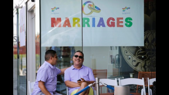 Jose Guerrero, left, and Patrick Rodriguez chat before their wedding ceremony in West Hollywood on July 1.