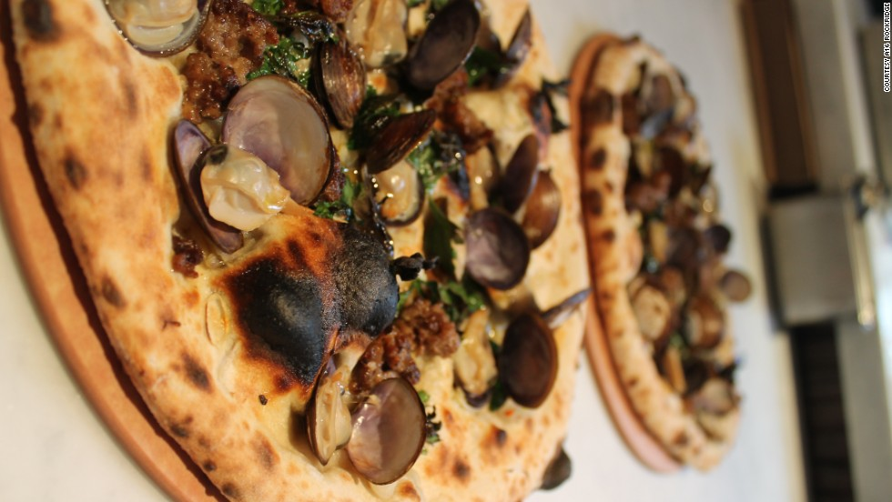 A16 Rockridge's Salsiccia e Vongole pizza is topped with manila clams in the shell. They steam open as the pie bakes in the oven, and clam juice seeps into the pie.