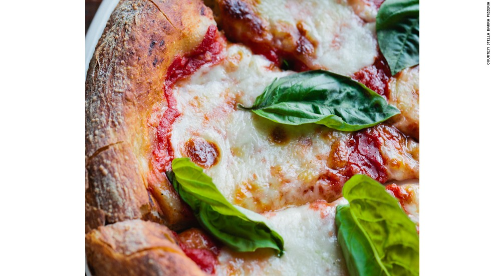 Stella Barra Pizzeria's open pizza kitchen turns out 400-500 pizzas a night.