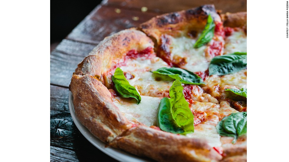 Stella Barra's classic 'Margherita' pie features sweet basil, organic extra-virgin olive oil and fresh mozzarella.