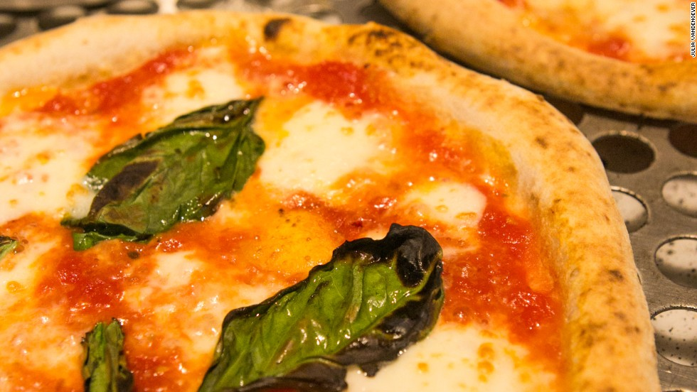 At Pizzeria Locale, each individual Neapolitan-style pie spends exactly two minutes rotating through a revolving-door oven, as it gets blasted with heat.