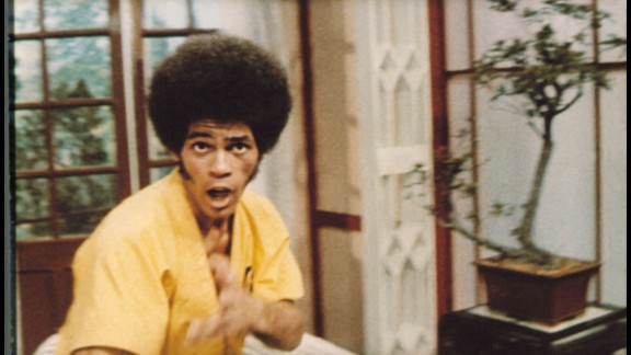 "Jim Kelly, seen here in his best known film ""Enter the Dragon,"" died of cancer June 29 at the age of 67."