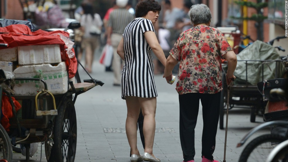 "JULY 2 - SHANGHAI, CHINA: A mother and daughter walk together on July 1. <a href=""http://cnn.com/2013/07/02/world/asia/china-elderly-law/index.html?hpt=hp_c3""><br />A new national law</a> introduced this week requires the offspring of parents older than 60 to visit their parents ""frequently"" and make sure their financial and spiritual needs are met. A third of China's population will be classed as elderly by 2050, <a href=""http://cnn.com/2013/07/02/world/asia/china-elderly-law/index.html?hpt=hp_c3"">according to Xinhua.</a>"