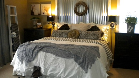 Holly Browning, from Midlothian, Virginia, says she automatically feels relaxed and sexy when she lies down in her bed. Her Shabby Chic bedroom that combines vintage and industrial accents is also focused on texture, especially in the bedding.
