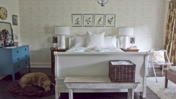 Milk and Honey Home decorator Julie Holloway, from Roswell, Georgia, kept her own bedroom light and bright by painting her bed frame white. The blue dresser adds some fun to the calm scheme.